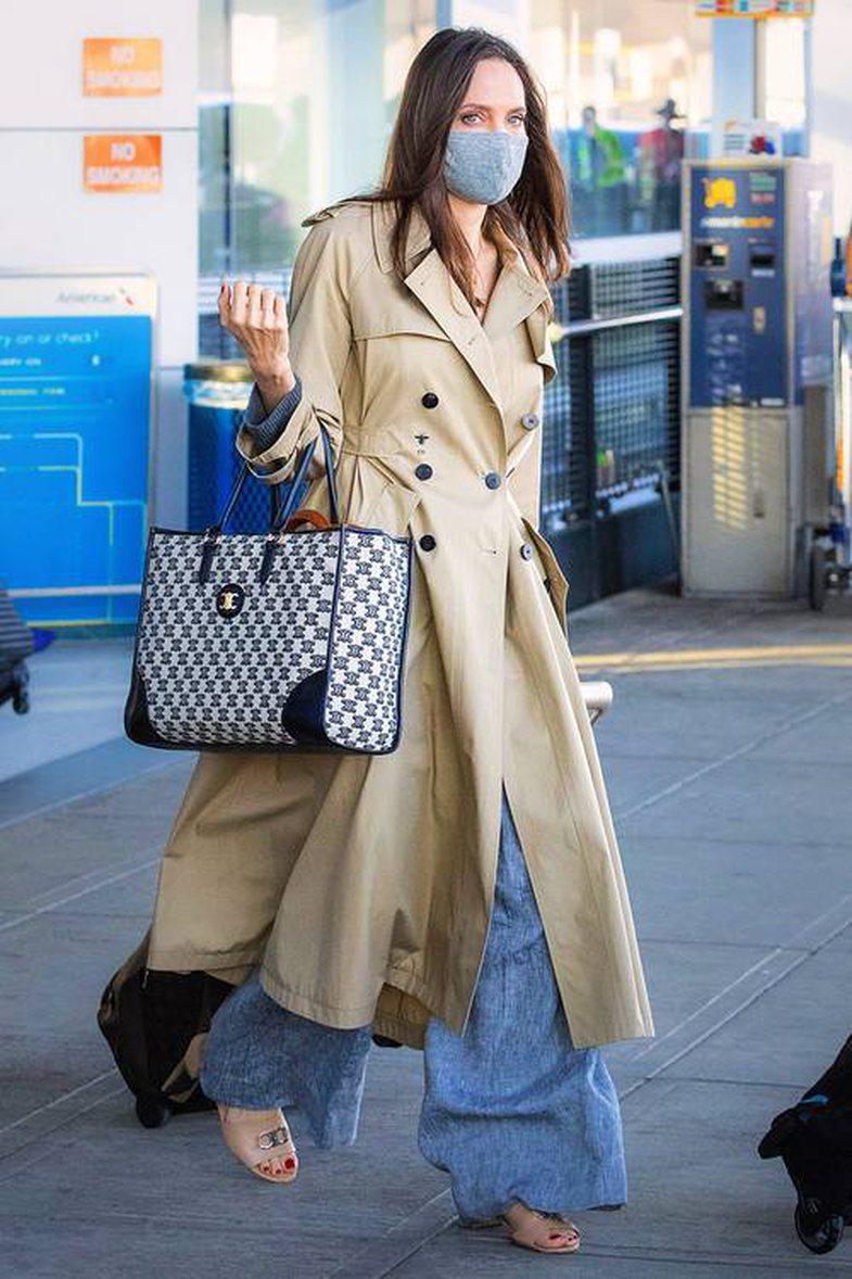 Ndoshta, pantallonat e Angelina Jolie-s në aeroport janë më